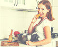 Young happy woman cook vegetable salad on kitchen vegetarian Royalty Free Stock Photo