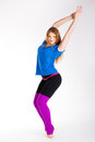 Young happy woman does fitness exercise and stretching on white background Stock Photos