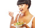 Young happy woman eating salad isolated on white Stock Photos