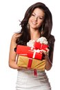 Young happy woman with a gift shocked holding box white background isolated Royalty Free Stock Images