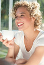 Young happy woman having morning cup of coffee Stock Images