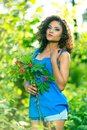 Young happy woman holding big bouquet of spring flowers outdoors Stock Photos