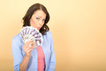 Young happy woman holding money looking pleased and delighted a dslr royalty free image of attractive for self a fan of cash or Royalty Free Stock Photo