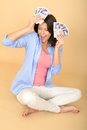 Young happy woman holding money looking pleased and delighted a dslr royalty free image of excited screaming a two fans of cash or Stock Photo