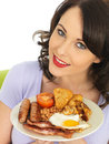 Young happy woman holding plate of full english breakfast a dslr royalty free image a attractive a white two or sausages cooked Royalty Free Stock Photography