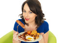 Young happy woman holding a plate of full english breakfast dslr royalty free image or one sausage two or hash browns or two Stock Images