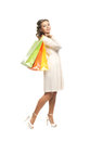 A young and happy woman holding shopping bags Royalty Free Stock Images
