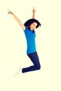 Young happy woman jumping in the air Royalty Free Stock Photo