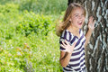 Young happy woman screaming and laughing amazed teenage girl in park copyspace on summer outdoors background Stock Images