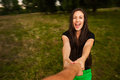 Young happy woman spinning around holding man's hand Royalty Free Stock Photo