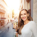 Young happy woman standing with glass of champagne Royalty Free Stock Photo