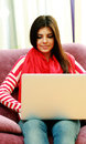 Young happy woman using laptop at home Royalty Free Stock Images