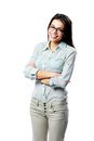 Young happy woman wearing glasses with arms folded isolated on white background Royalty Free Stock Photo