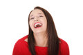 Young happy woman wearing red blouse is laughing. Royalty Free Stock Photo