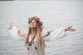 Young happy woman wearing tradisional closes and wreath Royalty Free Stock Photo