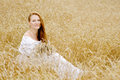 Young happy woman in wheat field Royalty Free Stock Photo