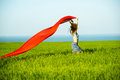 Young happy woman in wheat field with fabric Royalty Free Stock Photo