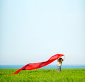 Young happy woman in wheat field with fabric. Summer lifestyle Royalty Free Stock Photo