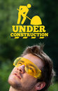 Young head looking at contruction icons persons construction signs Stock Images