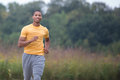Young healthy african american jogging outdoor under morning sunlight Stock Photo