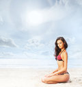 Young healthy beautiful and sexy woman on the beach sporty in swimsuit relaxing Royalty Free Stock Photo