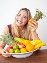 Young healthy beautiful woman with a bowl of fresh exotic fruit and natural looking Royalty Free Stock Image
