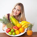 Young healthy beautiful woman with a bowl of fresh exotic fruit and natural looking Stock Photography