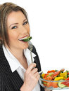 Young Healthy Business Woman Eating a Fresh Mixed Salad Royalty Free Stock Photo