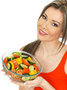 Young healthy happy woman holding a fresh mixed garden salad dslr royalty free image pretty glass bowl of freshly smiling happily Royalty Free Stock Image