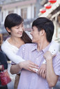 Young heterosexual couple looking at each other outdoors in beijing Royalty Free Stock Image