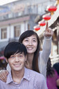Young heterosexual couple pointing outdoors in beijing Stock Photos