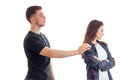 Young high guy holds the girl`s shoulder hand