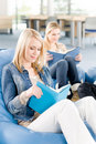 Young high-school student girls read books Stock Photos