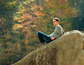 Young hiker relaxing on rock Stock Image