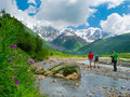 Young hikers trekking in svaneti georgia shkhara mountain the background Royalty Free Stock Photo