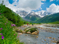 Young hikers trekking in svaneti georgia shkhara mountain the background Stock Photos