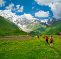 Young hikers trekking in svaneti georgia shkhara mountain the background Royalty Free Stock Photography