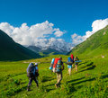 Young hikers trekking in svaneti georgia shkhara mountain the background Royalty Free Stock Images