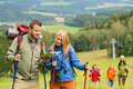Young hiking friends reading map find track Royalty Free Stock Photo