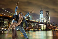 Young hip hop couple dancing over urban background Stock Photo