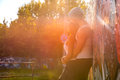 Young hiphop couple hugging in a urban environment styled love during sunset r Stock Photo