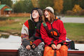 Young hippie man and woman in autumn park couple relaxing Royalty Free Stock Photography