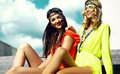 Young hippie women girls in summer sunny day in bright colorful cloth Royalty Free Stock Photo