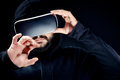 Young hipster bearded man in black hooded top, wearing virtual reality goggles Royalty Free Stock Photo