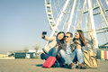 Young hipster best friends taking a selfie at luna park Royalty Free Stock Photo