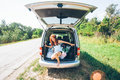 Young hipster friends on road trip on a summers day. Euro-trip Royalty Free Stock Photo