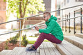 Young hipster man with smartphone in city Royalty Free Stock Photo