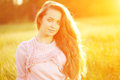 Young hipster model woman Casual Girl in field in Sunset in spring, summer landscape background Springtime Summertime. Allergic t Royalty Free Stock Photo