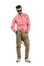Young hipster with questioning look above sunglasses bearded full body length portrait isolated over white background Royalty Free Stock Image