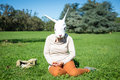 Young hipster rabbit mask woman on the phone Royalty Free Stock Photo